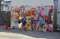 Kids painting a mural