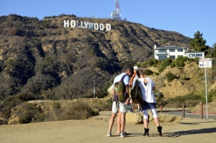 Tourists checking their pictures at the Hollywood sign