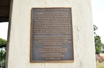 Plaque telling about Mission Playhouse