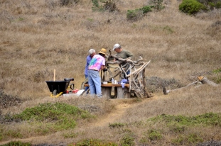 Volunteer artists building a new bench along Fiscalini trail
