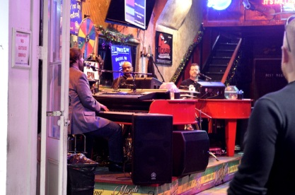 Dueling pianos in a bar on Bourbon Street