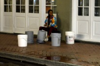 Street musician. Man, could she drum those buckets!