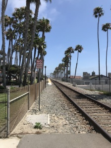The train stops directly in front of the pier